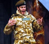 Colour picture of Mark Rice Oxley as Borachio, act one, scene one.