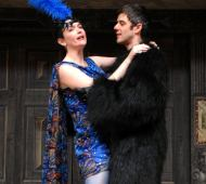 Colour image of Rachael Spence and Mark Rice Oxley as Margaret and Borachio, act two, scene one.